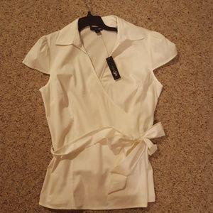New, white shortsleeve faux wrap blouse.